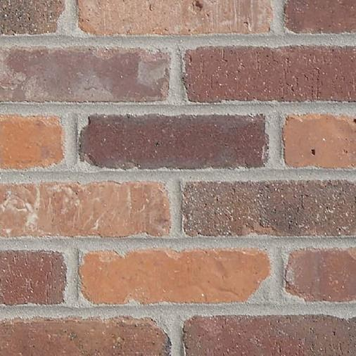 A close - up of a brick wall  Description automatically generated