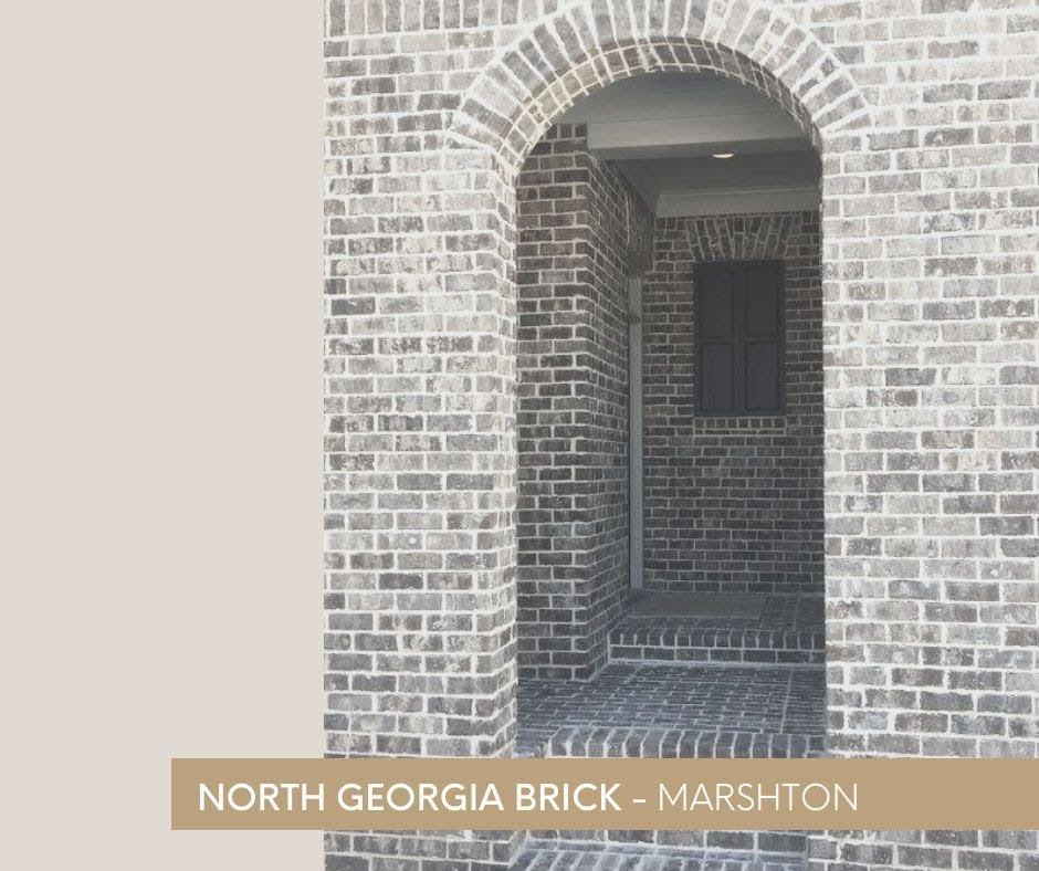 A picture containing text, building, brick, arch  Description automatically generated