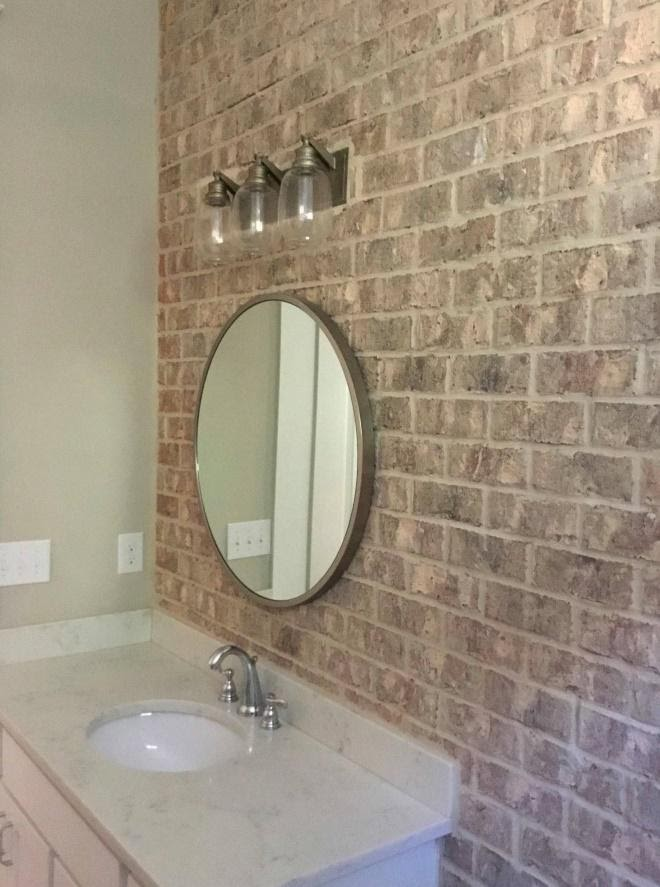 A bathroom with two sinks  Description automatically generated with low confidence